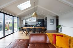Open plan living, dining and kitchen with large windows and high gable ceilings Ceiling Beams, Ceilings, Drinks Cabinet, Open Plan Kitchen, Open Plan Living, Large Windows, Living Area, New Homes, Design Inspiration