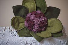 One big felt flower with small flowers inside. simple en beautifull. Custom…