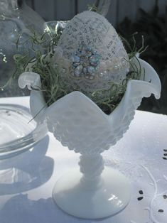Opulent Cottage Decoupage eggs then decorated with lace, buttons and broach.