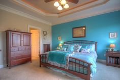 Traditional Master Bedroom with Carpet, Crown molding, flush light, Ceiling fan, High ceiling