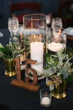 Romantic Navy Blue and Greenery Inspired Lakeland Wedding Navy Blue Wedding Reception Decor, Wooden Lasercut Table Number, Glass Cylinders with Candles and Green Plant in Gold Vases on Navy Blue Sating Linen Blue Wedding Receptions, Wedding Reception Decorations, Wedding Themes, Reception Ideas, Decor Wedding, Event Ideas, Party Ideas, Gold Wedding Centerpieces, Flower Centerpieces