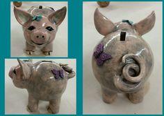 Hand-built clay pinch pot piggy bank.