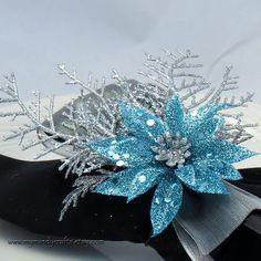 Set of 4 - Glittery Blue Poinsettia with Silver Evergreen Napkin Ring. $15.00, via Etsy.