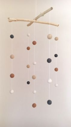 Felt ball mobile, driftwood, earthy tones by GentlyDrifting on Etsy https://www.etsy.com/listing/271120368/felt-ball-mobile-driftwood-earthy-tones
