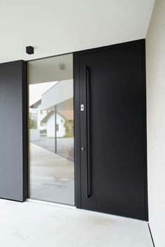 reflective mirrored glass pivot door...