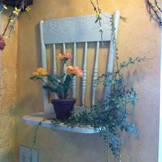 Chair turned into a wall pot holder. İt's a very neat idea.