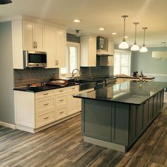 What an incredible transformation!!! loving the contrast of the cabinets, island and flooring!! Such a fun project!