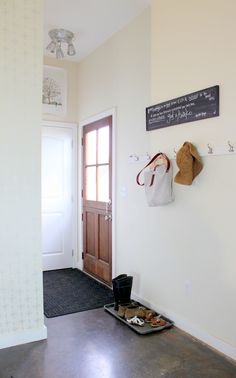 Ah, this is what we need in that little corner by the back door!  Chalkboard plaque and hooks, that's all