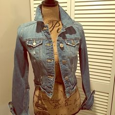 American Eagle distressed denim jacket Distressed denim jacket from American eagle. Only worn a few times and no longer fits me. I Love the wash of it and the button detailing!! American Eagle Outfitters Jackets & Coats Jean Jackets