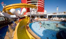 Mickey's Pool, a children's pool located at Deck 9, Aft aboard the Disney Magic and the Disney Wonder and at Deck 11, Midship aboard the Disney Dream and the Disney Fantasy, includes a 2-foot-deep main pool with Mickey Mouse's smiling face and, nearby, a twisting one-deck-high slide.