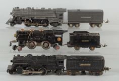 First set: No. 259 Steam Locomotive- black, early version with the red drive wheels and copper and brass trim, complete and all original, scratching and paint chips throughout, in very good condition. Tender - complete and all original, scratching and paint chips throughout, in good condition. Second set: No. 204 Steam Locomotive - black, complete and all original, in excellent condition. No. 2689W Whistle Tender - complete and all original, scratching and paint chips throughout, some spots…