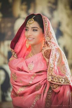 Traditional Indian bride wearing bridal lehenga, jewellery and hairstyle.