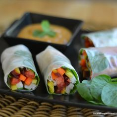 Carrots, jicama, lettuce, watercress, basil. Roll in Vietnamese rice paper. Sauce: ground chia seeds, peanut butter, sesame oil, coconut milk, nam pla (fish sauce), Honey.  Tried it. Delicious and felt great.