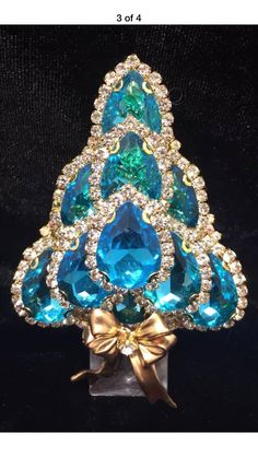 Sold by:ArtisanJewelryLaHeircustomer out of 5 stars Rhinestone Jewelry, Vintage Rhinestone, Vintage Brooches, Vintage Costume Jewelry, Vintage Costumes, Antique Jewelry, Vintage Jewelry, Jeweled Christmas Trees, Jewelry Tree