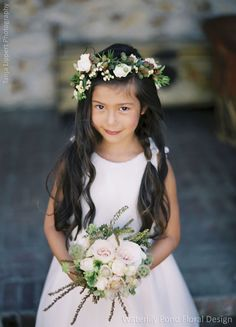 Flower girl crown has an enchantingly woodsy mix of berries, roses and greens. Wedding Flowers: Waterlily Pond Floral and Event Design   Wedding Photographer: Tanja Lippert Photography
