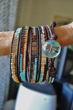 GRAND CANYON 5 Wrap Leather Bracelet with Japanese Miyuki Delica & Tila Beads and a vintage glass Czech iridescent Dragonfly Button on Etsy, $108.00