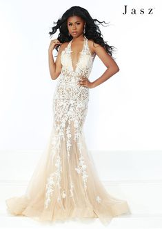 bcaf175d556 Style 6401 from Jasz Couture is a plunging V halter mermaid gown with  floral applique and