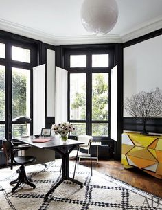 http://blog.laurelandwolf.com/black-white-the-design-power-couple/  Design inspiration for the sun room, gloss black trim playing up an eclectic cocktail of Victorian, Modern Art, with a twist of tribal flair
