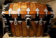 http://www.brettunsvillage.com. Great source for trunk parts and directions for how to refinish trunks.
