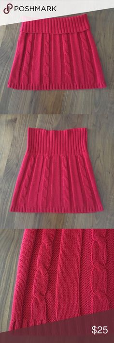"""Urban Outfitter - Kimchi Blue Cable Knit Skirt Purchased at Urban Outfitter this Kimchi Blue pull on skirt. It is red cable knit with a roll over waist. It was worn a few times. Very unique skirt. It is 15"""" long from the top of the naturally folded waist to hem. Waist circumference is 28"""". Looks new. No holes, stains, etc. The only thing I see is a glitch in the knit on the waistband. Not sure if I did something or if it came that way, but you have to really look to see it (see pics). Made…"""