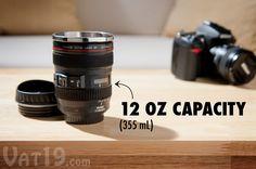 Camera Lens Mug sitting on a coffee table.