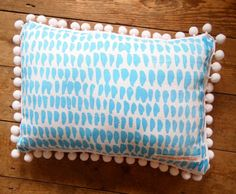 Double sided Hand Screen Printed Cushion in Linen with white extra large Pom Poms