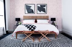 Geometric prints set the tone in the guest bedroom, which is decorated with a coral herringbone wallpaper from Serena & Lily and a graphic wool rug from West Elm | archdigest.com