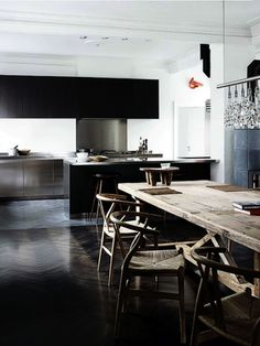 Natural wood, herringbone wood floor transition into ceramic, modern clean kitchen, contrasts and style. remove the chandelier!