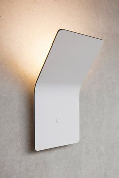 Wall lamp 'One' designed by Matthias, Simon and Jurgen Frech for their company FSING. Made of a 4mm thick alumnium composite hiding all electric systems. Nice.