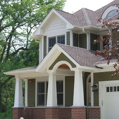 Exterior +brick+dark green painted cedar - Maybe cedar color trim instead of white paint.