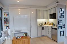 27 Best Examples of Murphy Beds and Tables ~ this photo shows kitchen, fold down table and Murphy bed up!