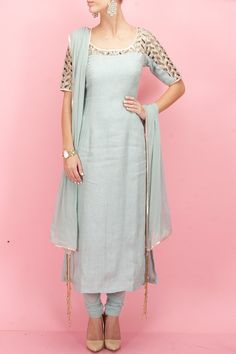 A gorgeous pale blue and gold Indian outfit