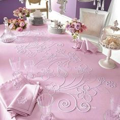 tablecloth with large-scale chain-stitch outline embroidery