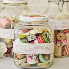 {like vintage spools, washi tape is too beautiful to be stored hidden away | lidded glass jars keep the dust away and makes a great display piece for a craft room}