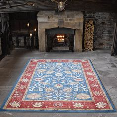 Ziegler Arak Rugs in Blue with a Rust border feature a Persian design with intricate detailing that is sure to be the focal point of your room