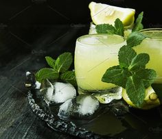 limoncello,Italian traditional liqueur with lemons on the vintage table. Food & Drink Photos