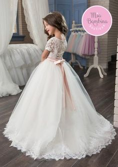 Everyone will love to see the Eugene flower girl dress on your little princess. This short sleeved ball gown with scoop neckline bodice and light flowing skirt