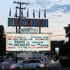 Cars line up under the sign for the Bengies Drive-In
