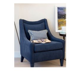 th2 Designs.© Navy arm chair with patterned cushion