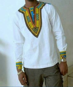 Nice casual Shirt with Dashiki print around the collar, neckline and on the cuffs. This Elegant Dashiki Shirt can be dressed up or down. Available in all sizes as well as different contrasting prints