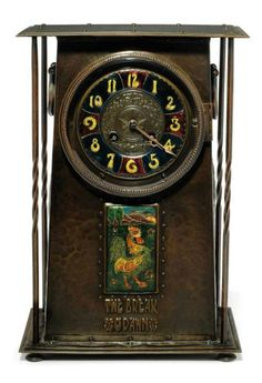 """AN ARTS & CRAFTS COPPER AND ENAMEL TABLE CLOCK  CIRCA 1900  HAVING A FRENCH GILT-BRONZE MOVEMENT; WITH STEPPED SURMOUNT AND BASE UNITED BY PART TWISTED RODS, THE HAMMERED CASE INSET WITH AN ENAMMELED PLAQUE HAND PAINTED WITH A COCKERAL IN A GARDEN AND EMBOSSED """"THE BREAK O'DAWN"""", THE SIDE EMBOSSED WITH STYLISED FLOWERS AND HAVING APPLIED HANDLES, THE DIAL WITH ENAMELLED ARABIC NUMERALS, MOVEMENT"""