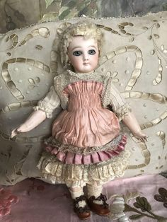 Early Jumeau size 2 with no flaws no hairlines chips repairs. Original body . Beautiful rose silk dress, cork pate, original wig and balls body. She
