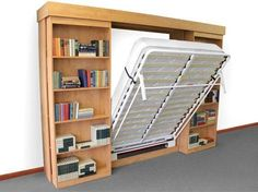 I like this idea...the murphy bed hides behind sliding bookshelves. A great idea to make a room have double duty as a guest room and office. Bookshelves, Bookcase, Murphy Bed Ikea, Murphy Bed Plans, Cool Rooms, Guest Room Office, Bedroom Office, Spare Room, Guest Bedrooms