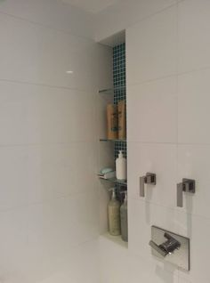 White large tile shower with full color non-bullnose tiles around shower niche Tile Shower Niche, Bathroom Niche, Condo Bathroom, White Bathroom Tiles, Tile Showers, Washroom, Master Bathroom, Large White Tiles, Recessed Shelves