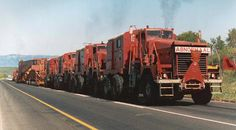 Miners in South Africa prefer to move loads not by rail (like in the USA, Germany, India and Japan), but - since they have huge open spaces - by means of the HUGE TRUCK TRAINS.
