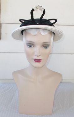 Please like my Facebook Page http://www.facebook.com/MyVintageHatShop for exclusive discounts and promotions.  Fun vintage hat circa 1948-1953.
