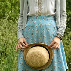 Pale blue floral skirt, white top, grey cardigan