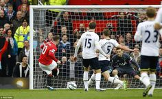 Lloris is given no chance as Rooney's shot is slid along the ground and well beyond the Fr...