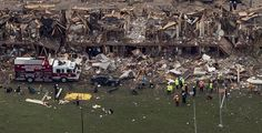 Police and rescue workers stand near a building which was left destroyed from a massive explosion at a nearby fertilizer plant in the town of West, near Waco, Texas April 18.