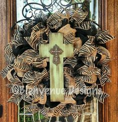 Zebra print ribbon and mesh wreath with a rustic cross!!! Bebe'!!! Love this wreath!!!
